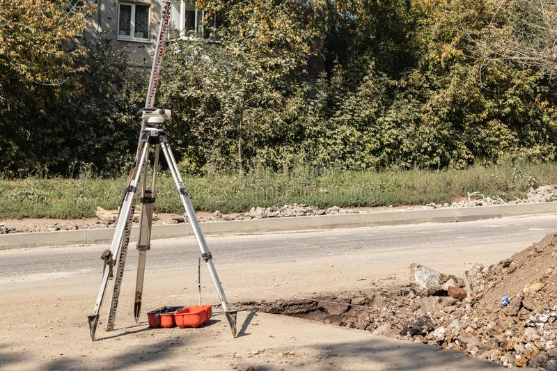Building surveying equipment theodolite level tool during the repair of the roadway. Tula region, Russia. Building surveying equipment theodolite level tool royalty free stock photos