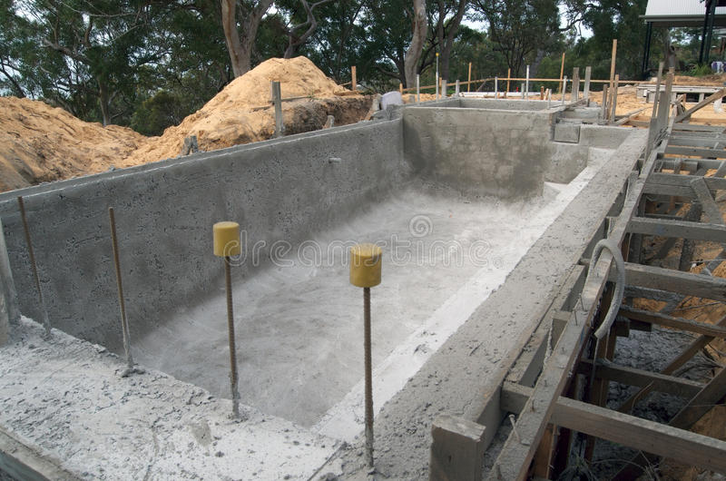 Building a swimming pool stock photo image of build - Swimming pool construction process ...