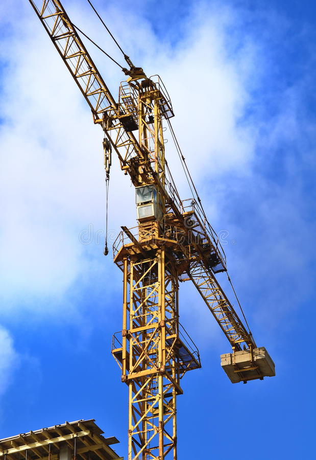 Building technics. ( load-lifting , the high-rise tower crane royalty free stock photography