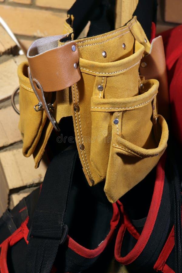 Building tool bag belt. Yellow tool bag. Leather bag.  royalty free stock photography