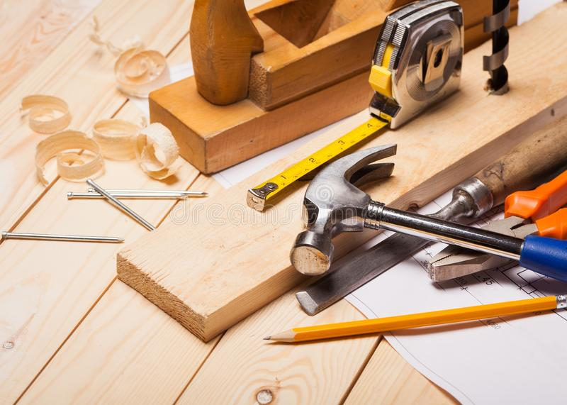 Various Building tools on wooden background stock photo
