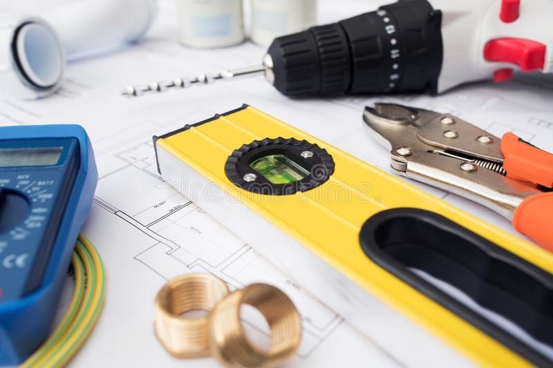 Building Tools And Components Arranged On House Plans stock photo