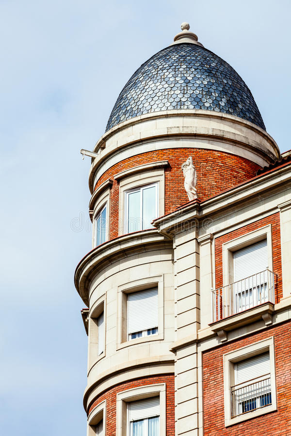 Building with a tower and domed roof. Spanish architecture. royalty free stock images