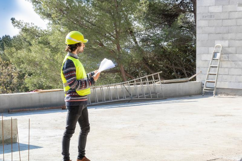 Building training, site visit, apprentice engineer on a construction site of house under construction. Construction site house, construction site visit stock photography