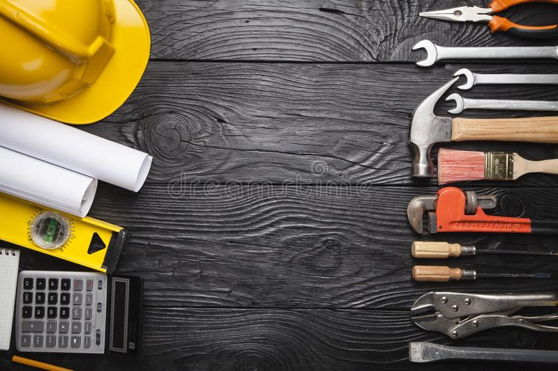 Building and treatment tools set on a wooden table royalty free stock photos