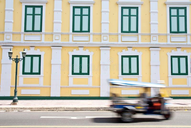 Building and Tuk Tuk car in Bangkok, Thailand royalty free stock photo