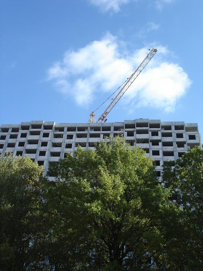 Building under construction, high-rise prefabricated house and a crane stock image