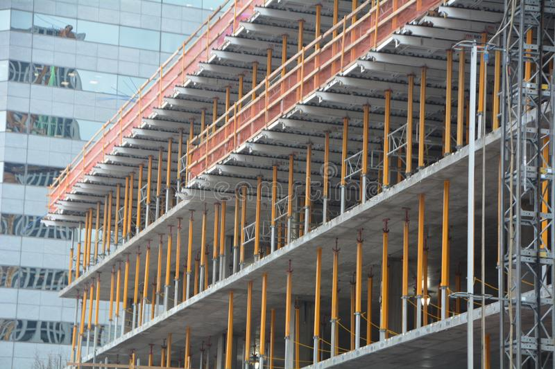 Building under construction in Portland, OR. This is an office building under construction in downtown Portland, Oregon. The skeleton forms a colorful pattern stock photos