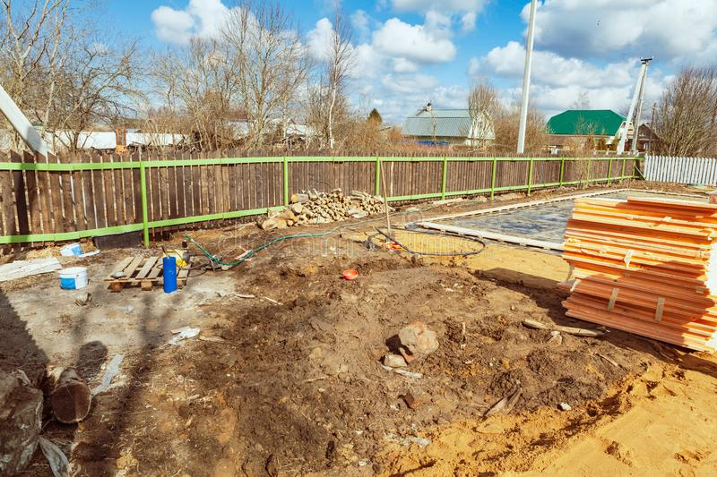 The building is under construction with new foundation after concrete pouring and making reinforcement metal framework stock photos