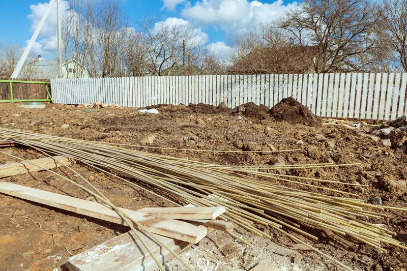 The building is under construction with new foundation after concrete pouring and making reinforcement metal framework stock image
