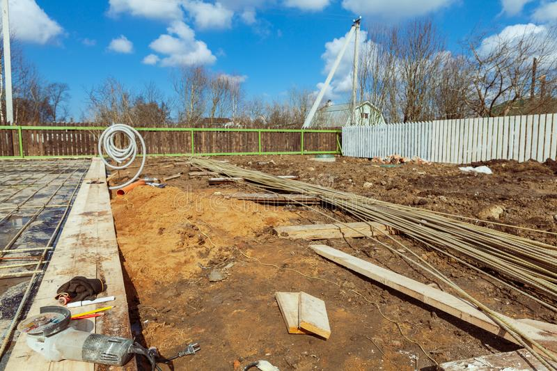 The building is under construction with new foundation after concrete pouring and making reinforcement metal framework royalty free stock image