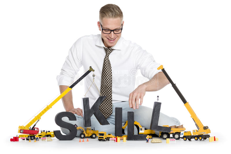 Download Developing Skills: Businessman Building Skill-word. Royalty Free Stock Images - Image: 30169399