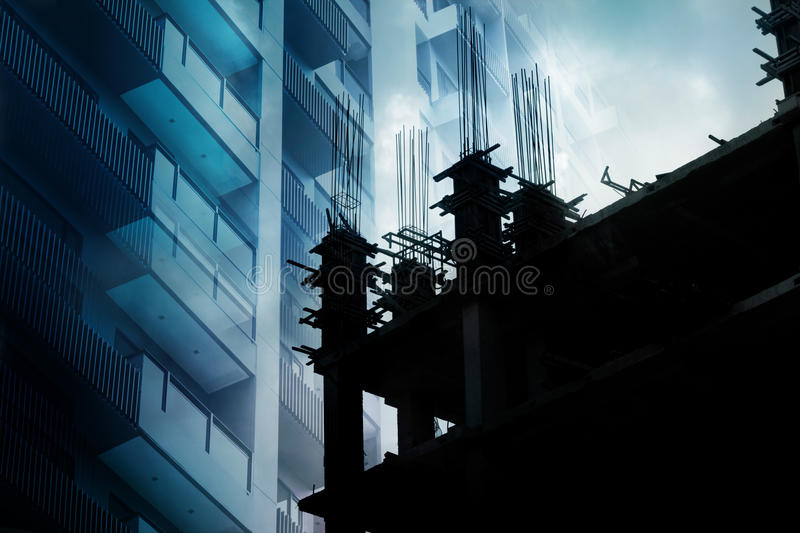 Building vibrant and under construction at dark blue tone, double exposure. Building vibrant and under construction at dark tone, double exposure royalty free stock images