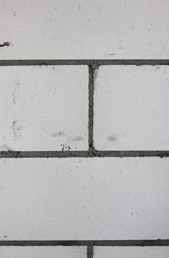 The building wall background. The grey bricks of the cement basis stock photos