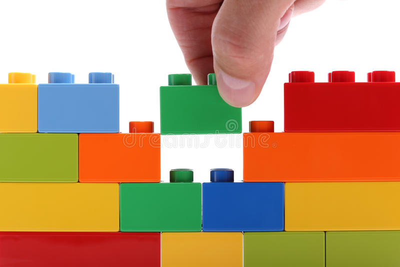 Building a wall from blocks royalty free stock photography