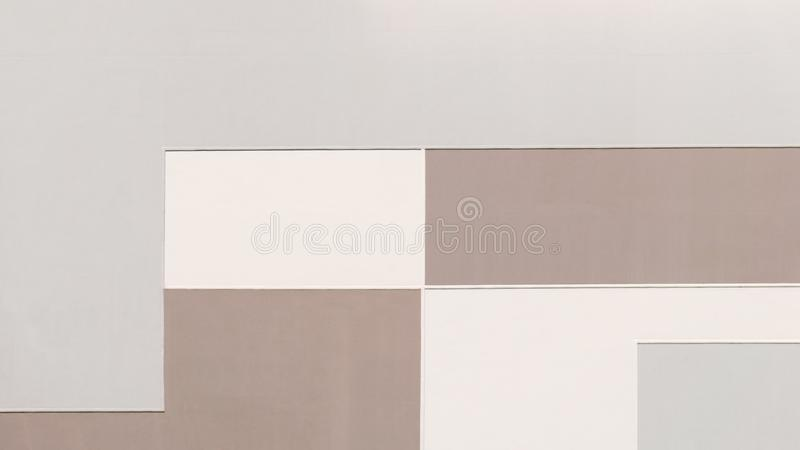 Building wall in pastel colors, geometric abstract background. Rectangular shape pattern, painted texture with straight angles. Wide photo for web site slider stock photos