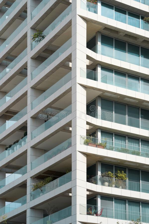 Building window close up.Texture. Angle modern business building skyscraper. Glass balconies in the building. Windows of facade. Modern apartment buildings in royalty free stock photo
