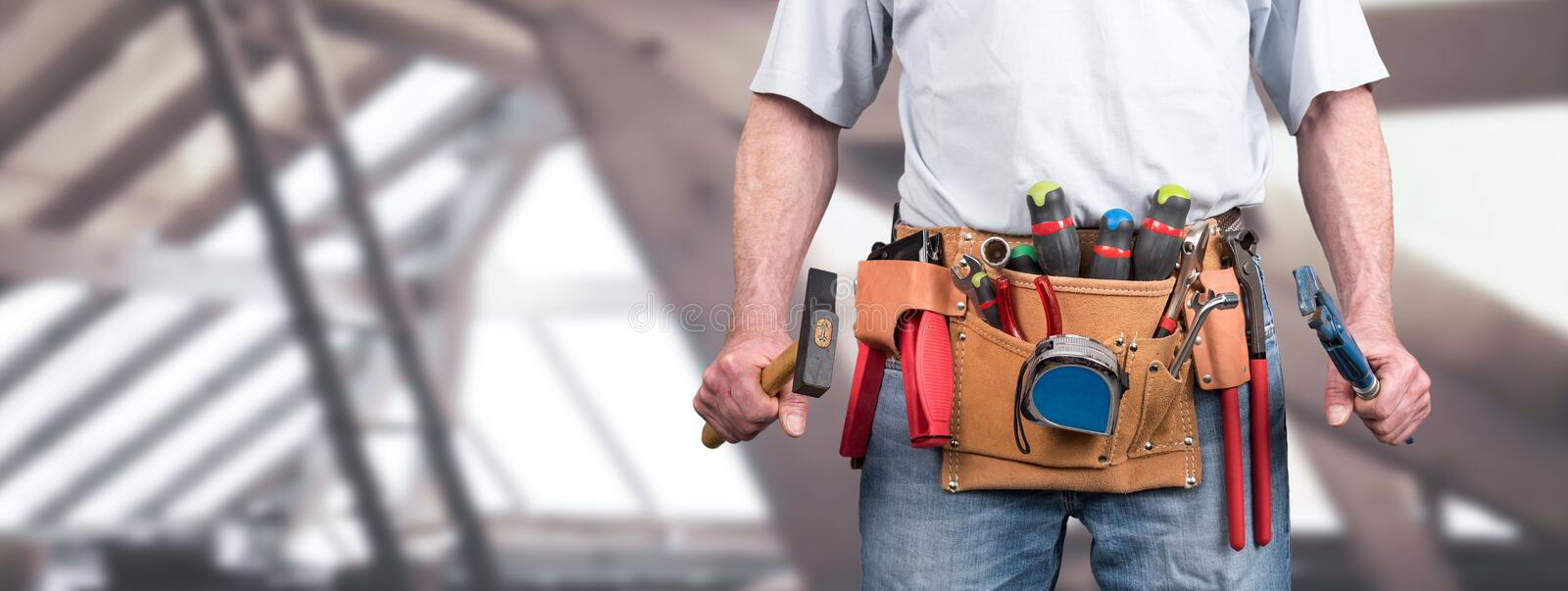Building worker with tool belt stock photos