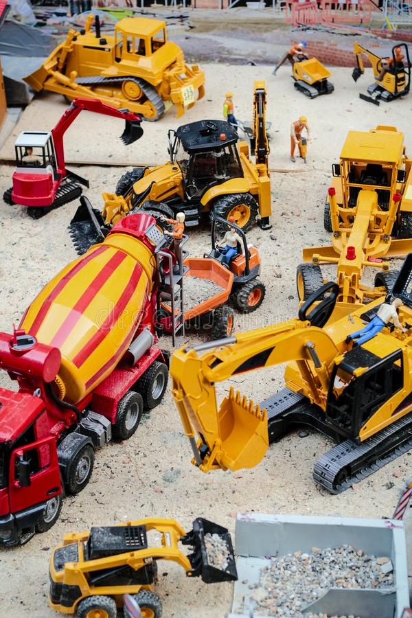 Building yard toy. The building yard in toy version, there are the crane and crawlers work stock image