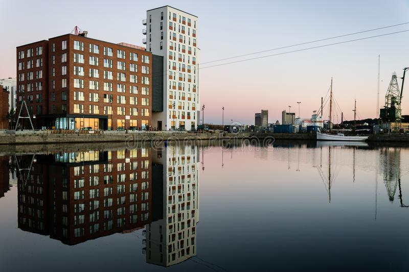 Reflections. Buildings in Aalborg, Denmark. Reflections in the water stock images