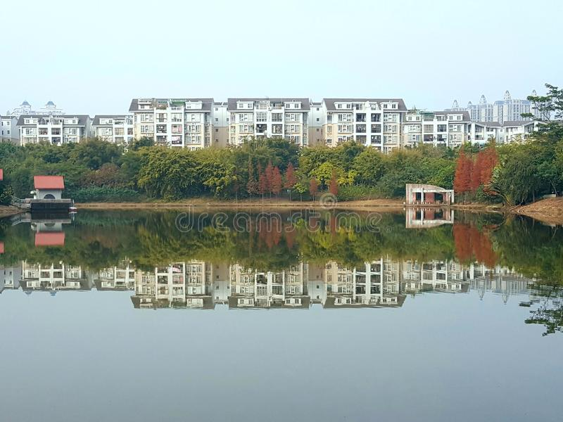 The buildings along the lake and their reflections form a belt. The long buildings along the lake and their reflections form a belt royalty free stock image