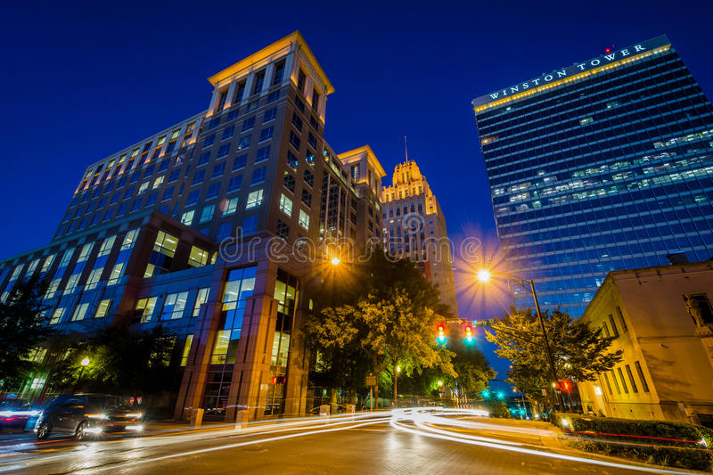 Buildings along 4th Street at night, in downtown Winston-Salem,. North Carolina stock photo