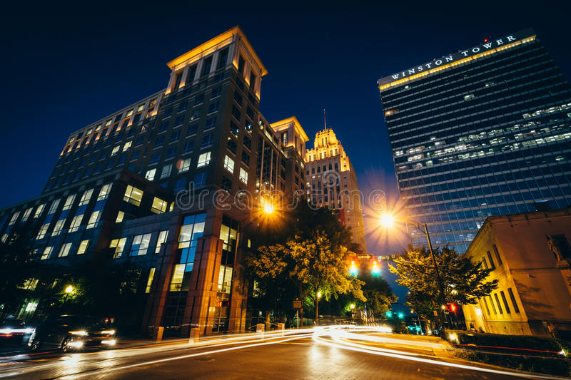 Buildings along 4th Street at night, in downtown Winston-Salem,. North Carolina stock photos