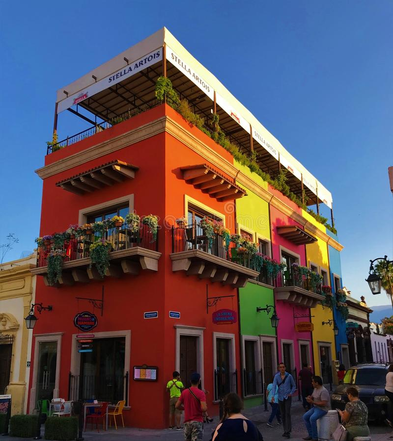 Buildings in Barrio Antiguo, Monterrey. Monterrey, Nuevo Leon, Mexico - October 23, 2017: Customers walk outside of a colorful restaurant building in the Barrio royalty free stock photography