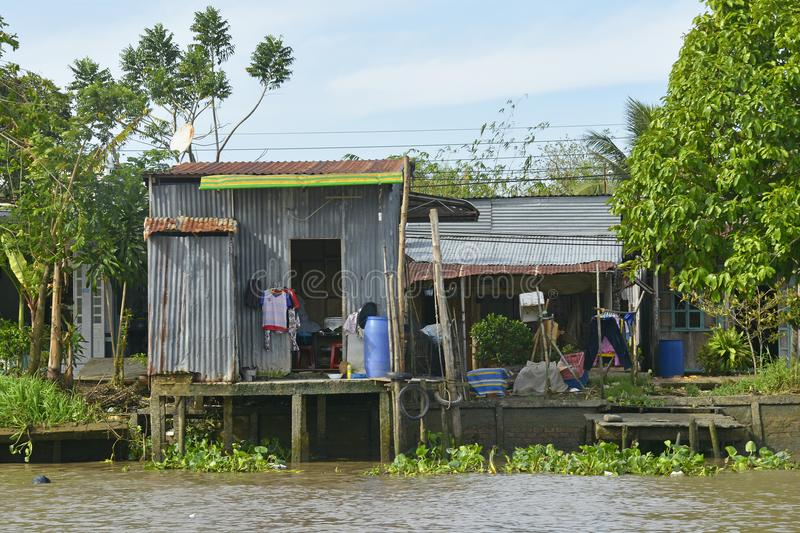 Buildings on Can Tho Waterway. Can Tho, Vietnam - December 31st 2017. Clothes dry outside at the back of a house which looks out onto a waterway near Can Tho in stock photo