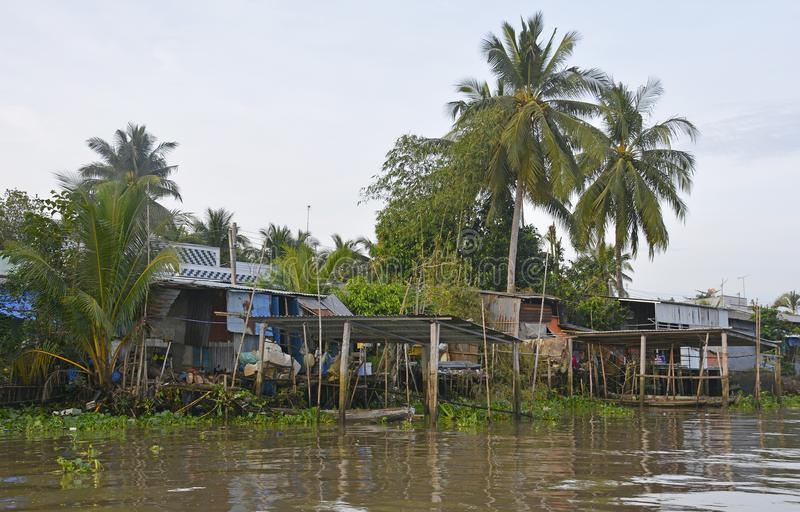 Buildings on Can Tho Waterway. Can Tho, Vietnam - December 31st 2017. A row of houses which look out onto a waterway near Can Tho in the Mekong Delta stock photo