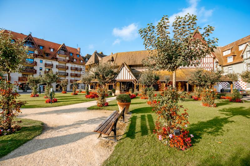 Buildings in Deauville city, France. Beautiful garden with luxury hotel building in the center of Deauville city, famous french resort in Normandy royalty free stock photography