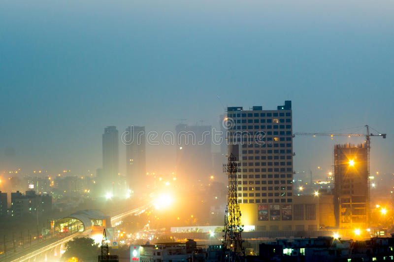 Buildings at dusk in Noida India. Noida, India - 16th Nov 2016: Buildings in Noida at dusk with the lights shining bright. The cityscape of noida is now being royalty free stock photo