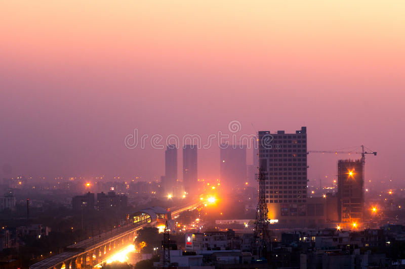 Buildings at dusk in Noida India. Noida, India - 16th Nov 2016: Buildings in Noida at dusk with the lights shining bright. The cityscape of noida is now being royalty free stock photography