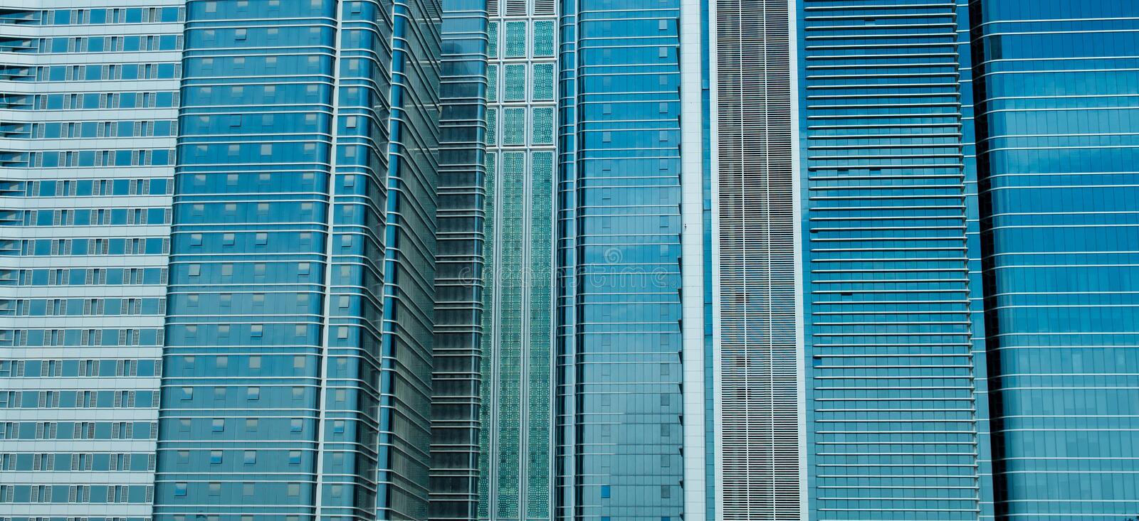 Buildings. Glass windows of office buildings royalty free stock photos