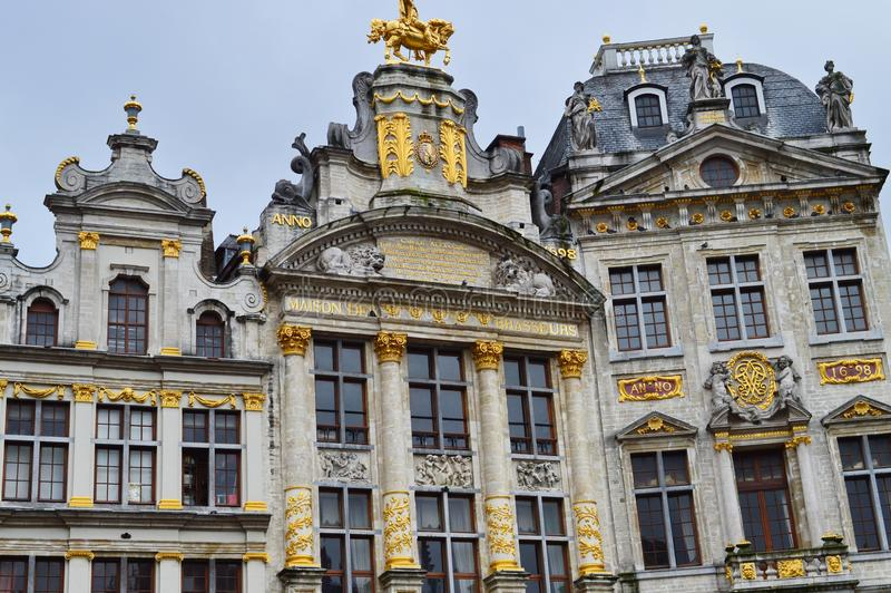 Buildings in The Grand Place or Grote Markt in Brussels, Belgium. The Grand Place is the central square of Brussels. It is surrounded by opulent guildhalls and stock photography