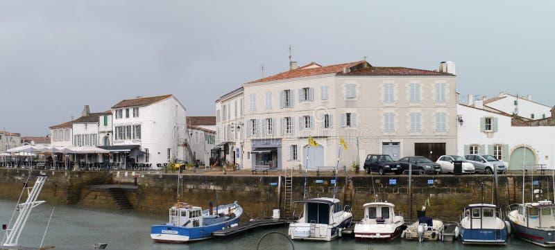 Buildings in harbour in St Martin de Re, Il de Re. Île of Ré, Vauban built a vast urban surrounding wall of huge dimensions and semicircle shape having a stock photos