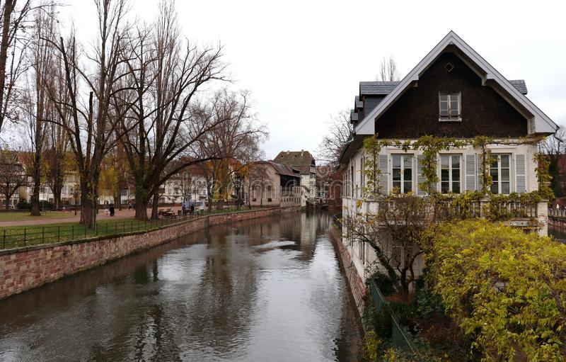 Buildings on the waterway in Strasbourg, France. Buildings and houses along the waterway in Strasbourg, France on a cold, wet, rainy day in December during the stock photography
