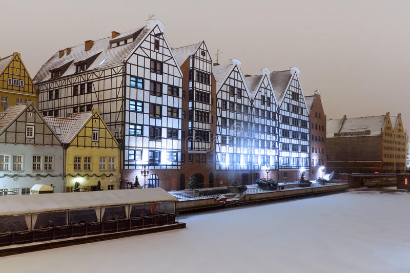 Buildings at Motlawa river in winter scenery royalty free stock images