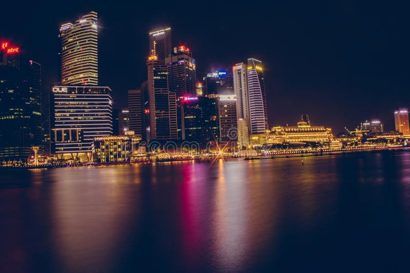 Buildings Near Body Of Water During Night Time royalty free stock images