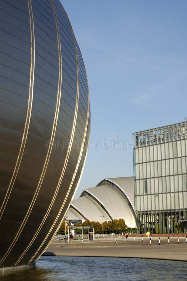 Buildings at Pacific Quay. The space age shell of the Imax cinema and the 'Armadillo' shape of the clyde auditorium at Pacific Quay, Glasgow stock image