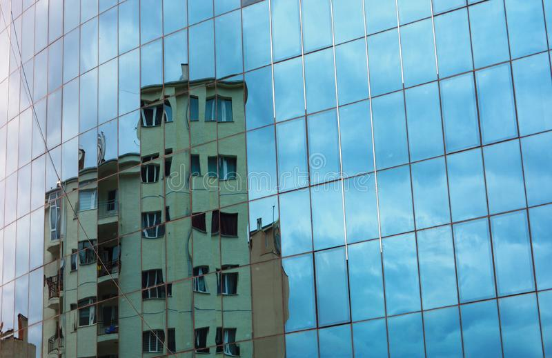 buildings reflected in windows royalty free stock image