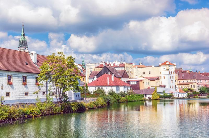 Buildings with reflections in water reservoir, Jindrichuv Hradec. Historic buildings with reflections in water reservoir, Jindrichuv Hradec, Czech republic royalty free stock images