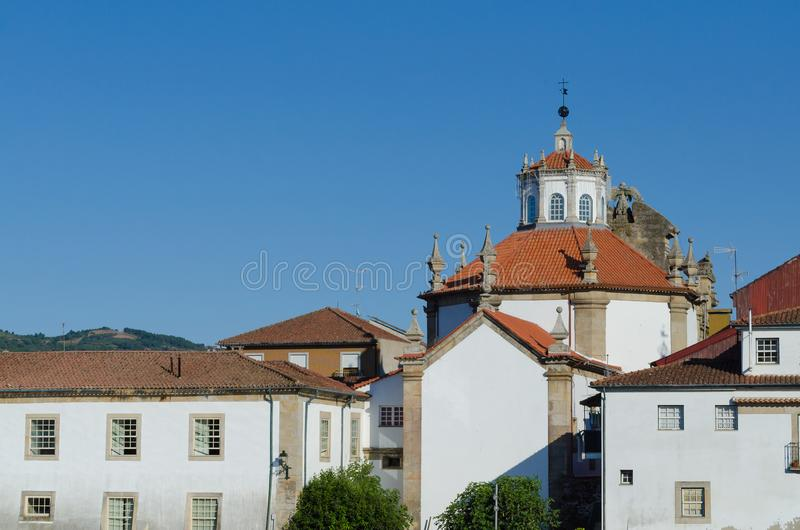 Church and houses, buildings in Chaves. Portugal. Buildings on the right bank of the Tâmega River, Chaves royalty free stock photography