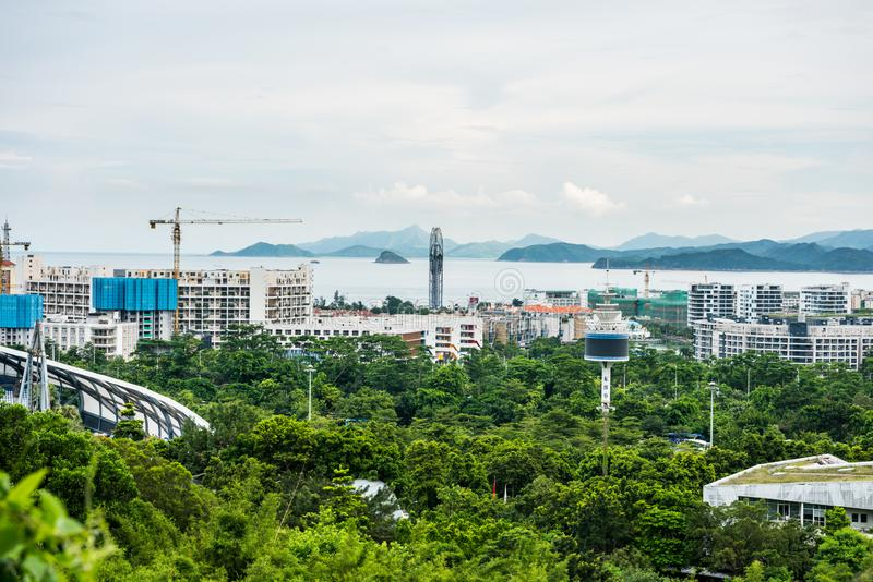 Buildings and sea at the costline of Shenzhen, view from the valley at Shenzhen Overseas Chinese Town East OCT East in Guangdong. China royalty free stock photos