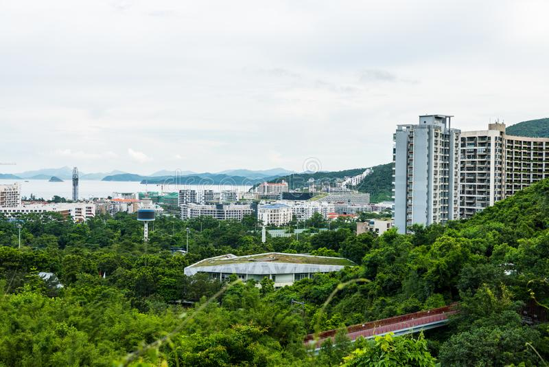 Buildings and sea at the costline of Shenzhen, view from the valley at Shenzhen Overseas Chinese Town East OCT East in Guangdong. China royalty free stock photography