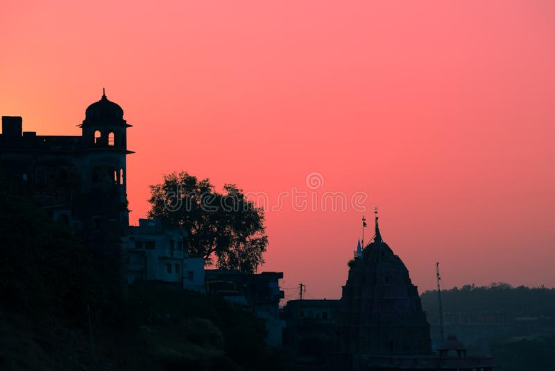 Buildings silhouette at sunset in India. Red orange purple colorful sky. Travel concept. Maheshwar palace and temple complex. Buildings silhouette at sunset in royalty free stock photo