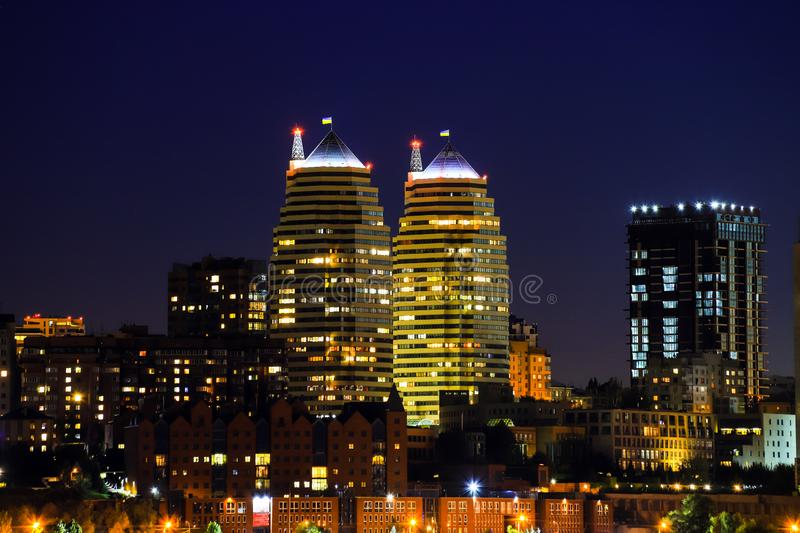 Buildings, skyscrapers and towers of the Dnepr city are reflected in the Dnieper River at night. Dnipro city stock photo