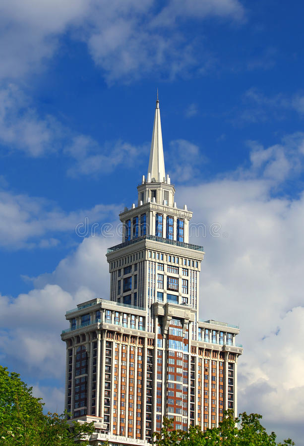 Buildings top with spire. Top of the huge residential building with white spire royalty free stock photography