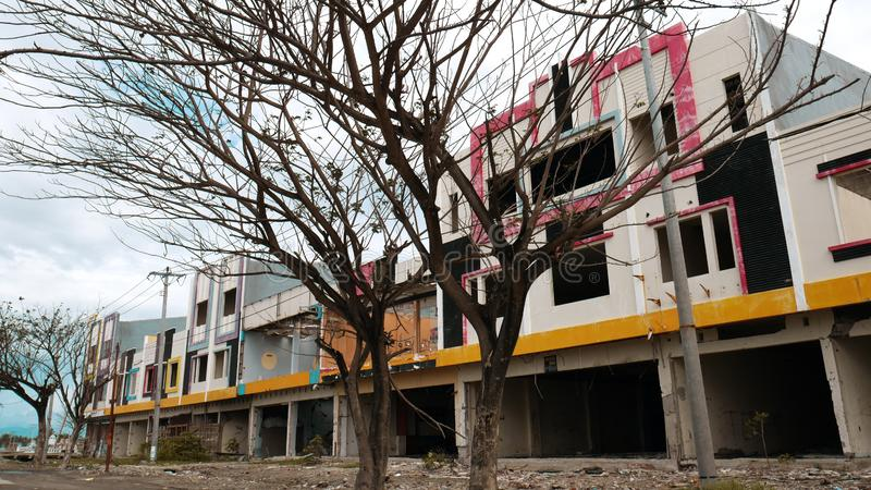 The Buildings after Tsunami. Buildings on the coast of Palu Bay after the earthquake, liquefaction and tsunami Sep 28, 2018 royalty free stock photography