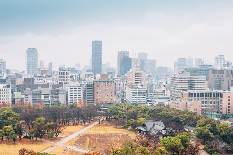Modern buildings and urban landscape at autumn from Osaka Castle in Japan. Buildings and urban landscape at autumn from Osaka Castle in Japan royalty free stock images